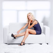 Blond girl on sofa — Stock Photo