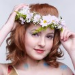 Royalty-Free Stock Photo: Redhead girl in garland