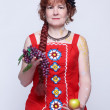 Senior woman with fruits — Stock Photo