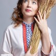 Folk woman harvester — Stock Photo