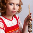 Folk girl with distaff — Stock Photo