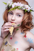Redhead girl with panflute — Foto de Stock