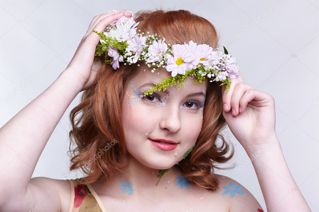 Portrait of beautiful slavonic redhead girl in flower garland — Stock Photo #8741316