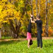 Couple practice yoga in forest — Stock Photo