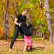 Couple practice yoga in forest — Foto Stock