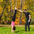 Stock Photo: Couple practice yoga in forest