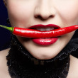 Beautiful girl with red chilli pepper — Stock Photo