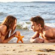 Foto Stock: Couple at beach