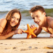 Couple at the beach — Stock Photo