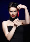 Beautiful brunette woman with cayenne — Foto de Stock