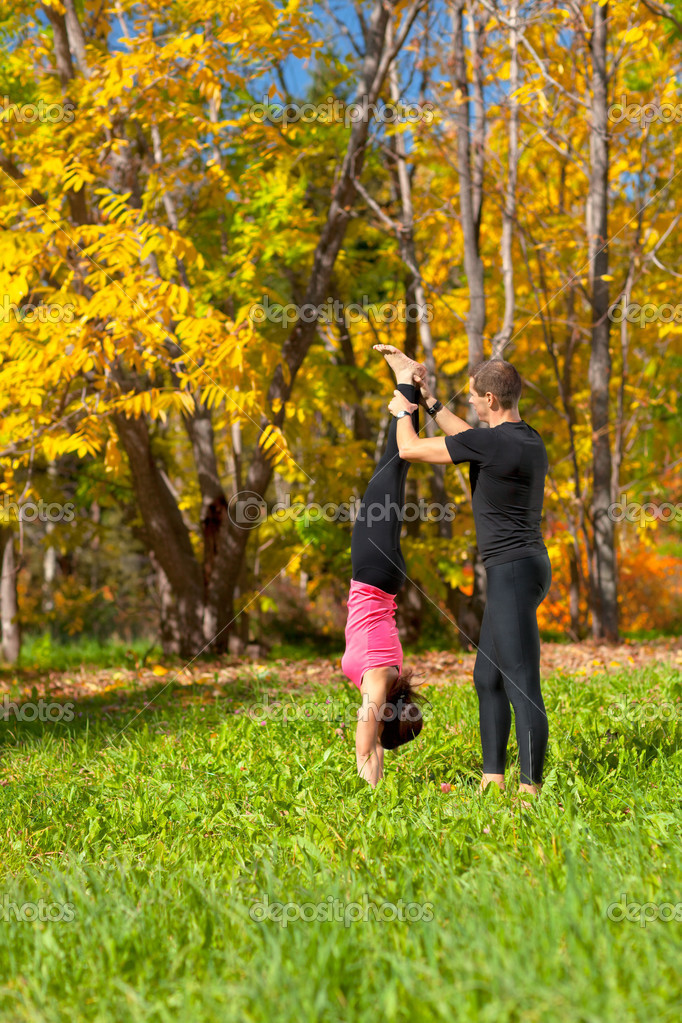 An attractive  man and woman practice Yoga in forest — Stock Photo #8800645