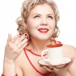Blonde woman with cup — Stock Photo #9348300