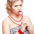 Blonde woman with lollipop — Stockfoto