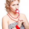 Blonde woman with lollipop — Stock fotografie