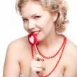 Blonde woman with lollipop — Stock Photo #9348325
