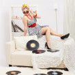 Blonde woman with vinyls — Stock Photo #9348372