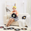 Blonde woman with vinyls — Stock Photo