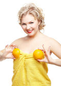 Blonde woman with orange — Stock Photo