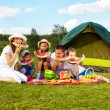 Family picnic in park - Stock Photo