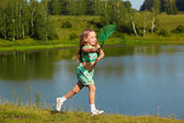 Girl with butterfly net — Stock Photo