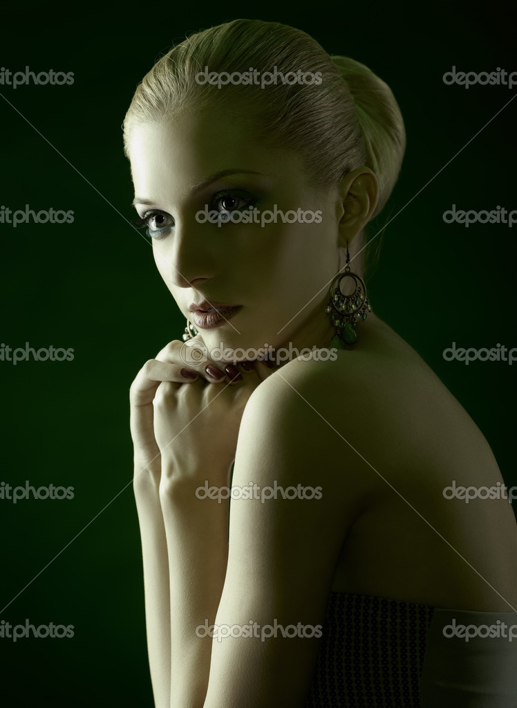 Green toned portrait of beautiful young blonde woman in jewelry — Stock Photo #9671493