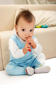 Baby with spoon — Stock Photo