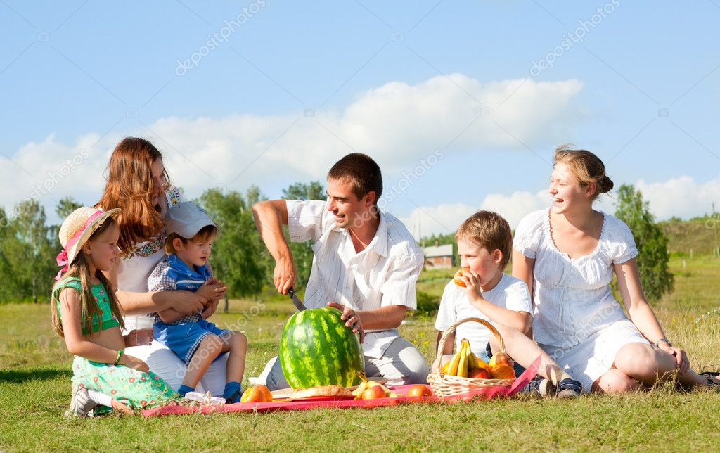 Happy family have a picnic outdoor  Stock Photo #10462894