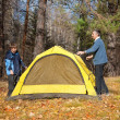 Tent in autumn forest — Stock Photo #10675467