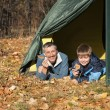Tent in autumn forest — Stock Photo