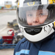 Racer in protective helmet - Stock Photo