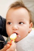 Eating baby — Stock Photo