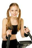 Chica con bicicleta de gimnasio — Foto de Stock