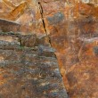 Foto de Stock  : Fractured cliff surface