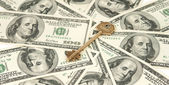 Dollars with a key — Stock Photo