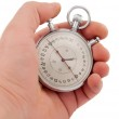 Stopwatch in hand isolated — Stock Photo