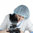Female student using a microscope — Stock Photo
