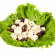 Stock Photo: Feta cheese with olives and lettuce on a plate