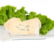 Stock Photo: Blue cheese with lettuce on a plate