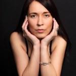 Portrait brunette woman on black background — Stock Photo #10033912