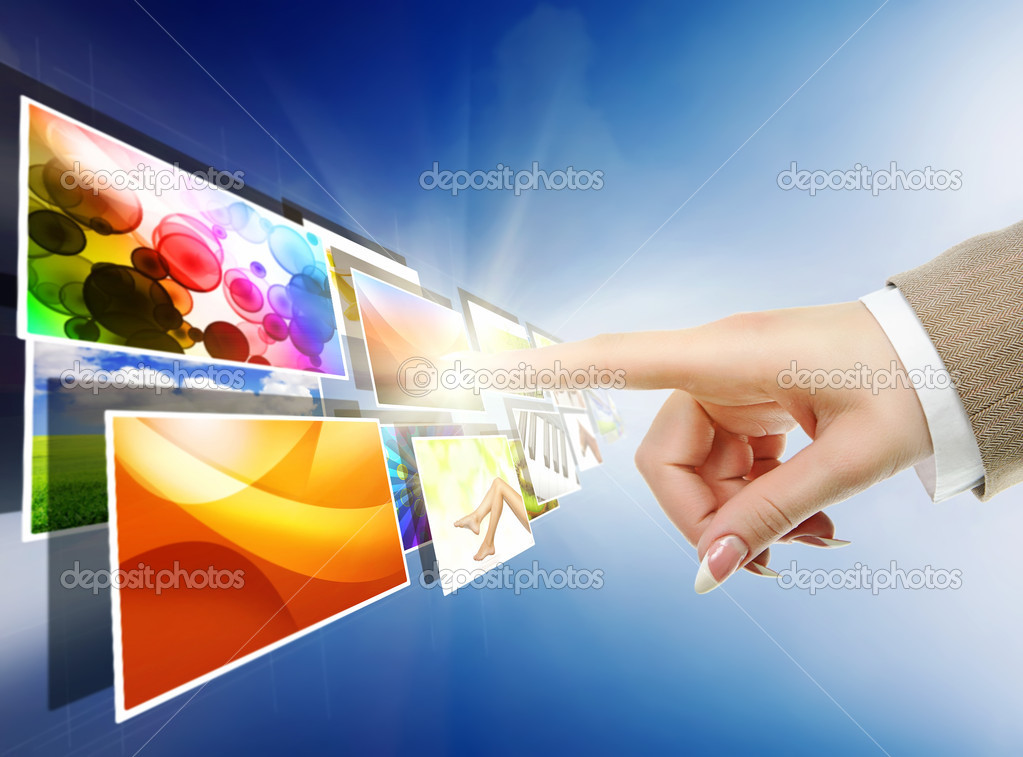 Hand reaching with the finger images streaming from the deep over sky blue background — Stock Photo #10033900