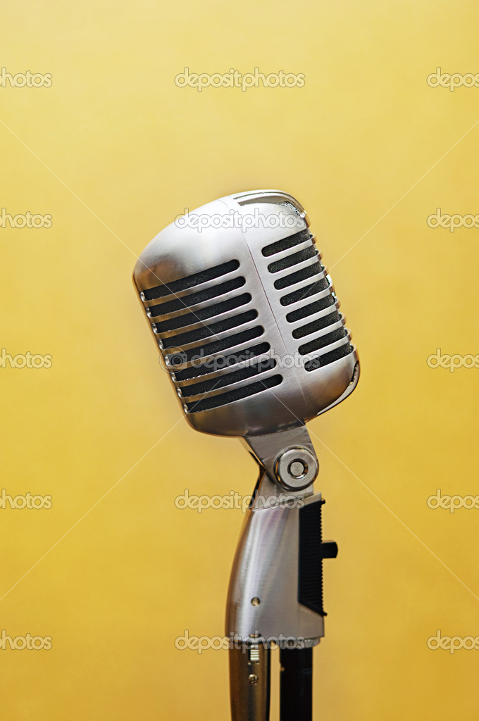 Retro vocal studio microphone over yellow background — Stock Photo #10352326