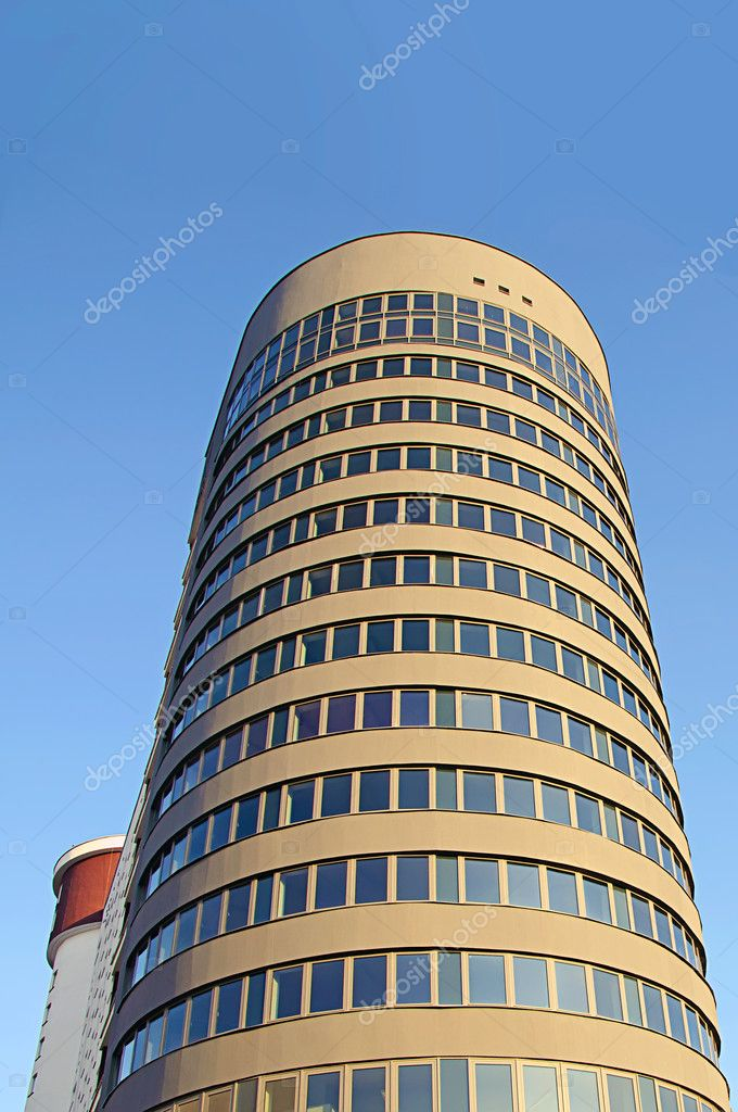 Modern brown office building over blue sky — Stock Photo #10553344