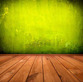 Dark vintage green room or interior with wooden floor and artist — Stock Photo