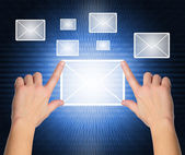 Female hand pressing e-mail sign on a touch screen interface — Stock Photo