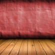 Dark vintage red room with wooden floor and artistic shadows add — Stock Photo
