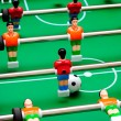 Soccer table game with green field and football players — Stok fotoğraf