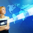 Stock Photo: Woman over world map sending email message via internet