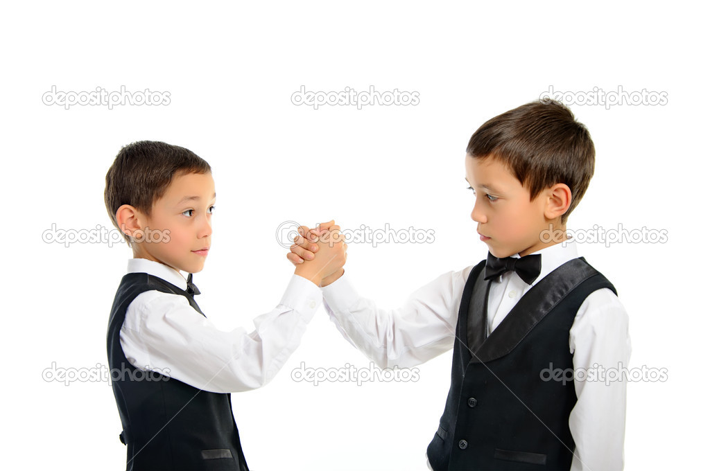 Two brothers twins playing arm wrestling isolated on white background — Stock Photo #9637272