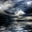 Dark cloudy stormy sky with clouds and waves in the sea — Stock Photo #9720313