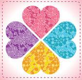 čtyři ozdobné srdce ve tvaru květin — Stock vektor